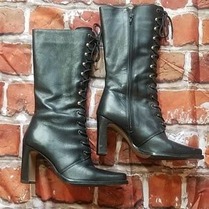 Zip up, calf high leather boot.